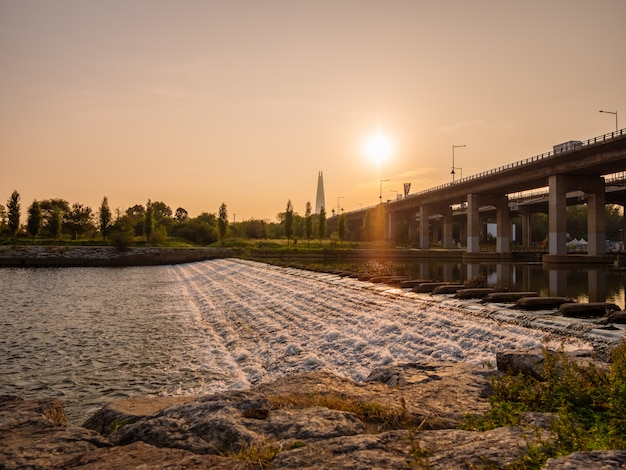 Morning sunrise near river and bridge in seoul