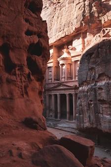 Morning view of al khazneh - rock cut temple, the treasury in ancient nabatean  city of petra, jordan.