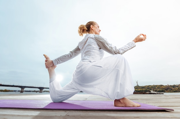 Morning yoga. the determined woman improving her health by practising yoga asanas