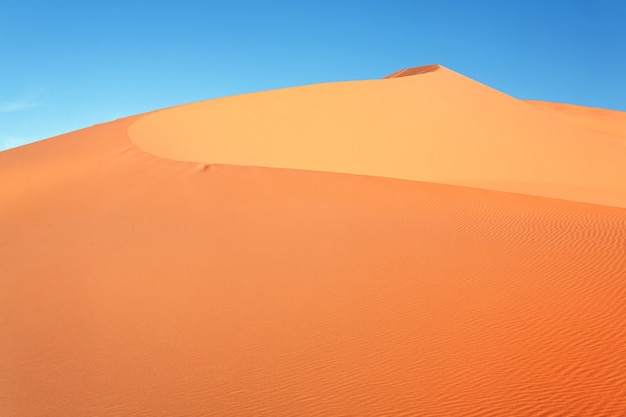 Moroccan desert dune background and blue sky