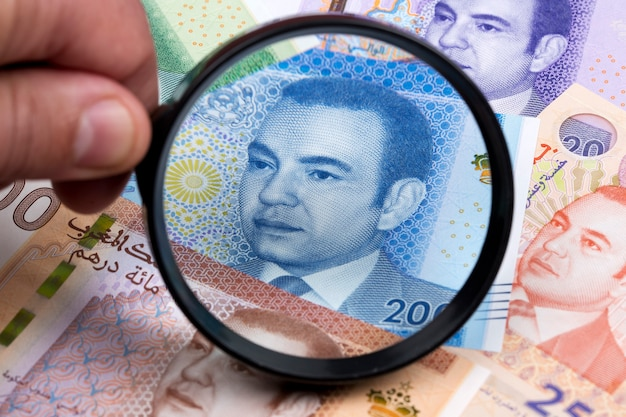 Moroccan dirham in a magnifying glass a business background