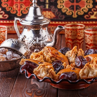 Moroccan mint tea in the traditional glasses with sweets