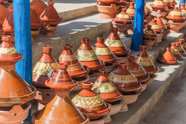 Moroccan tajine pottery for sale at the market in essaouira, morocco.