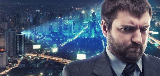 Morose businessman against night city
