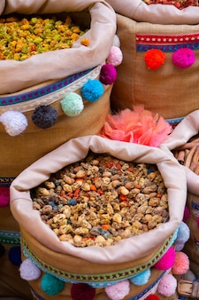 Morrocan local market on the streets with spices nuts fish fruits and vegetables