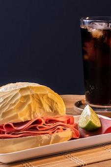 Mortadella sandwich on a white plate