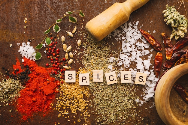 Mortar and pestle near spilled spices