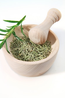 Mortar and pestle with salt and rosemary