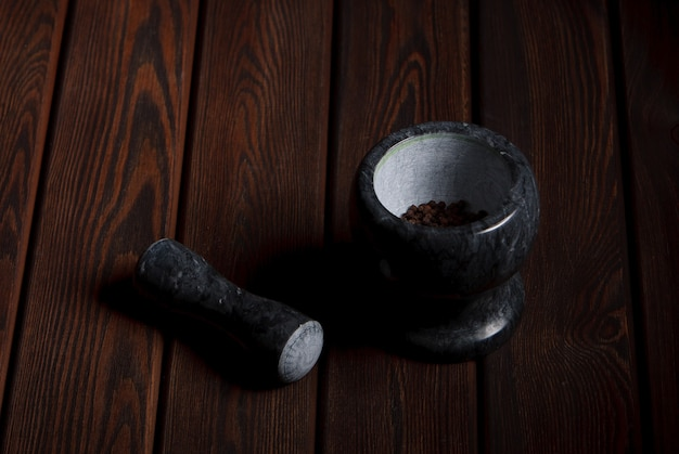 Mortar and pestle on the wooden table black background