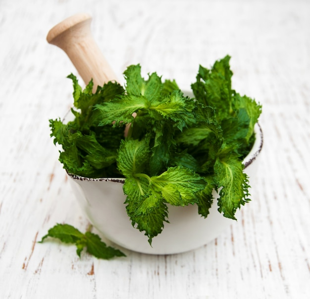 Mortar with green mint
