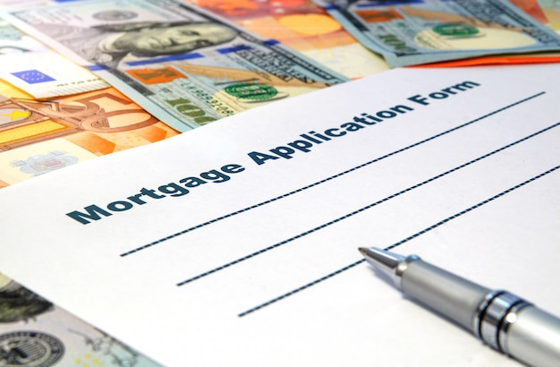 Mortgage application form with a pen and money
