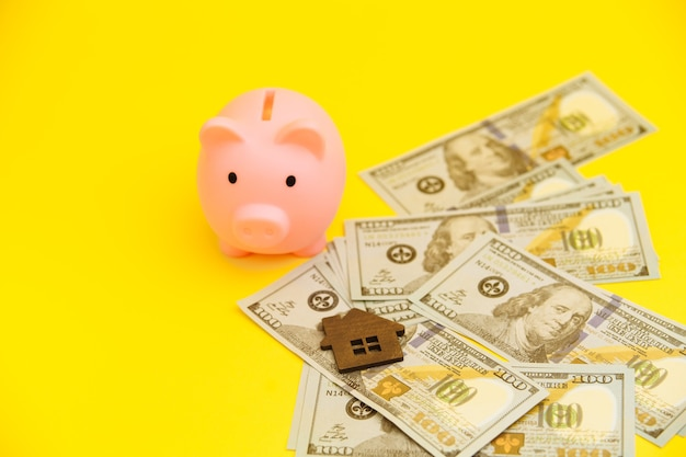 Mortgage concept. piggy bank and coins near.