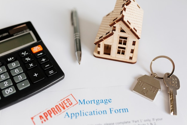 Mortgage contract and house figurine