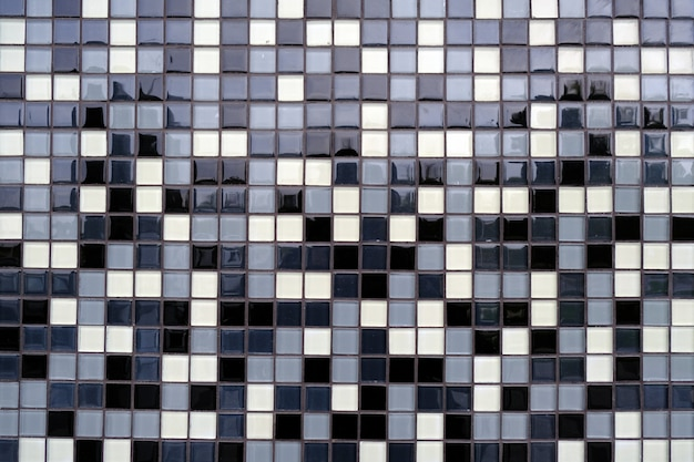 Mosaic background of black, white and gray ceramic tiles.