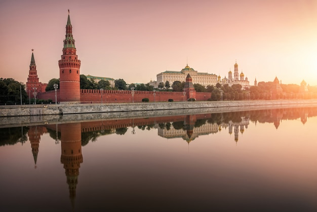 Moscow kremlin, the kremlin embankment with a mirror reflection in the water of the moscow river