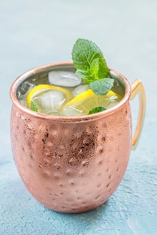 Moscow mule cocktail with ginger beer, vodka and lemon