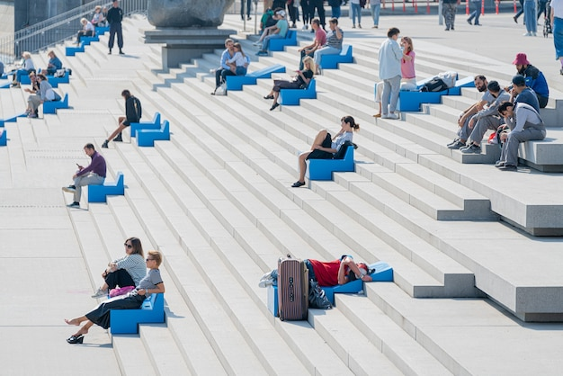 Moscow, russia. august 31. 2021. people sit and take pictures on the embankment.