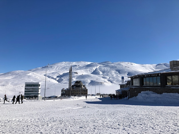 Mosque in the ski resort of erciyes, turkey. beautiful view, bright sun, snowy slopes.