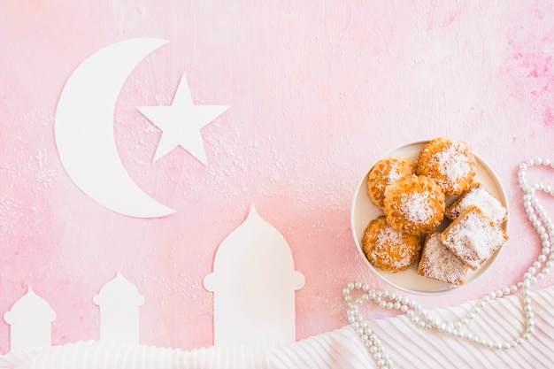 Mosque with crescent and sweets