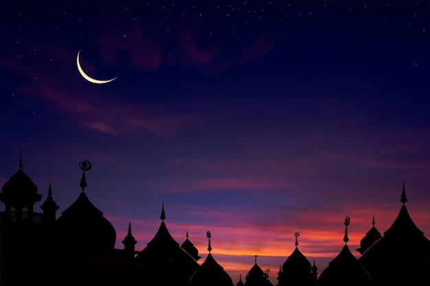 Mosques dome on dusk in the evening with crescent moon and star