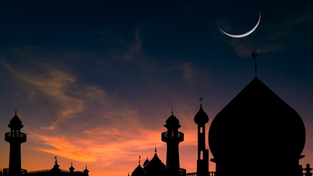 Mosques dome on twilight sky and crescent moon