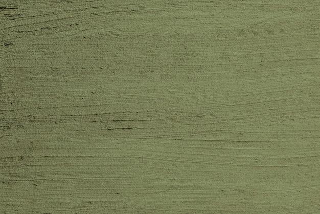 モスグリーンの壁のペンキの織り目加工の背景