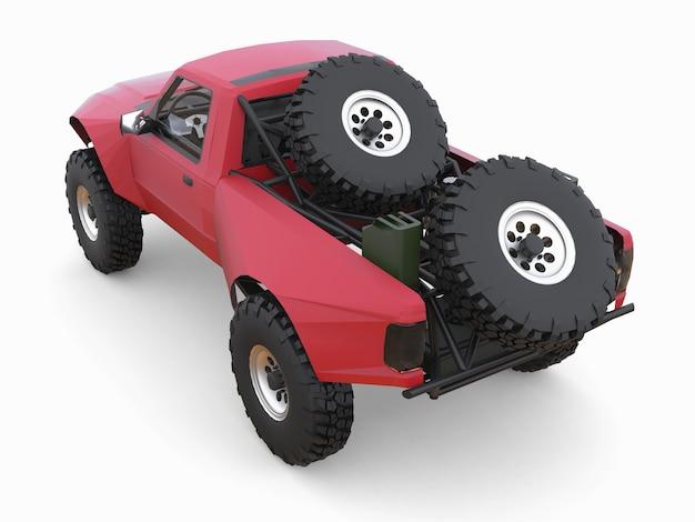 사막 지형을 위해 가장 많이 준비된 빨간색 스포츠 경주용 트럭.