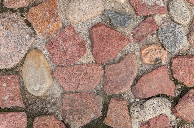 Mostly red granite stones pavement, pattern seamless, texture
