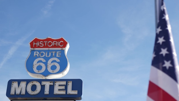 Motel retro neon sign on route 66, vintage symbol of road trip in usa. arizona desert. american flag