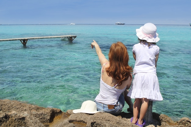 Mother ans daughter tourist formentera turquoise