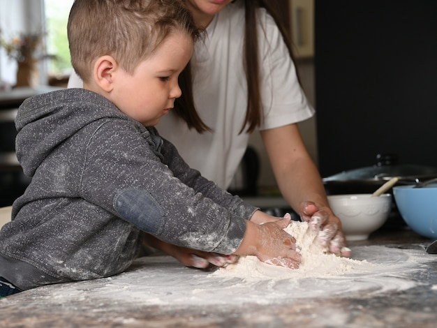 Mother and child bake at home