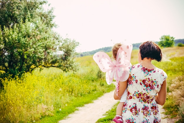 Mother and child daughter outdoors in summer