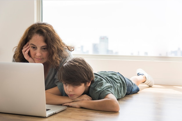 Mother and child looking on laptop
