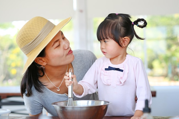Mother and child making homemade pancake