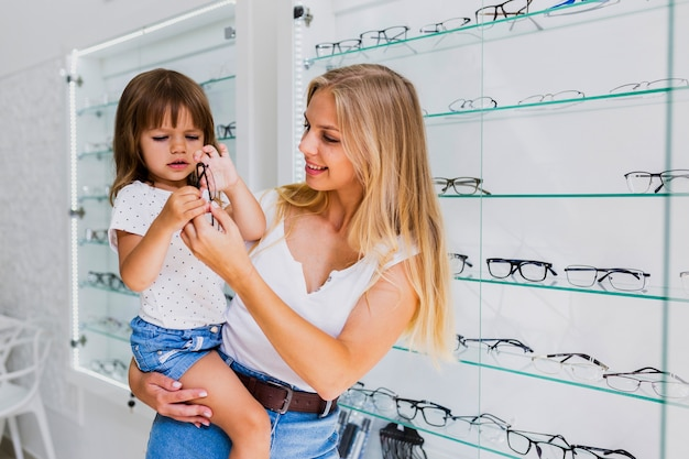 Mother and child at optician shop