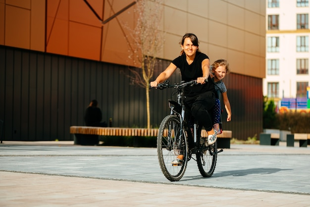 Mother and child ride a bike