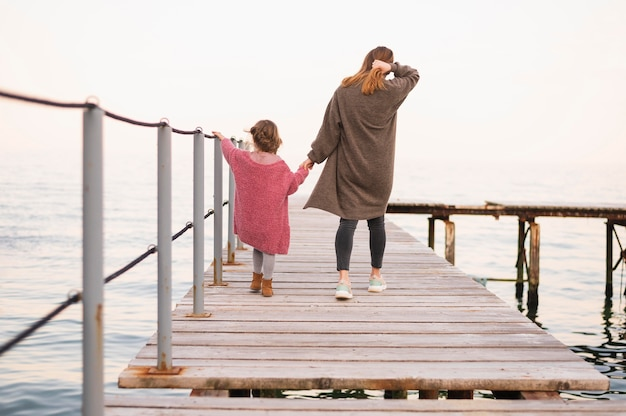 Mother and child walking together