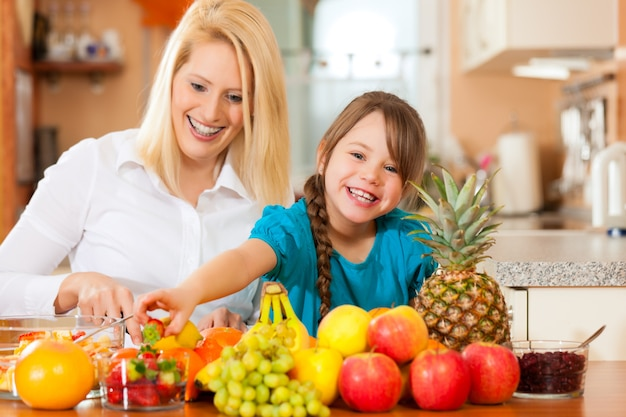 Mother and child with lots of fruits