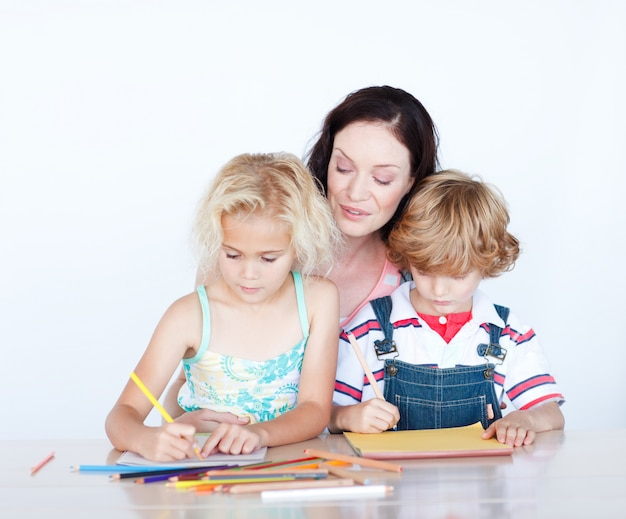 Mother and children writing together