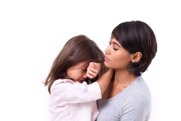 Mother comforting crying daughter, family problem solution