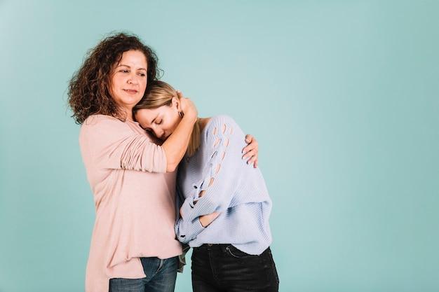 Mother comforting sad daughter