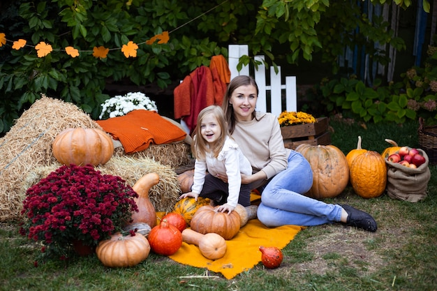 Mother and daughter in autumn background