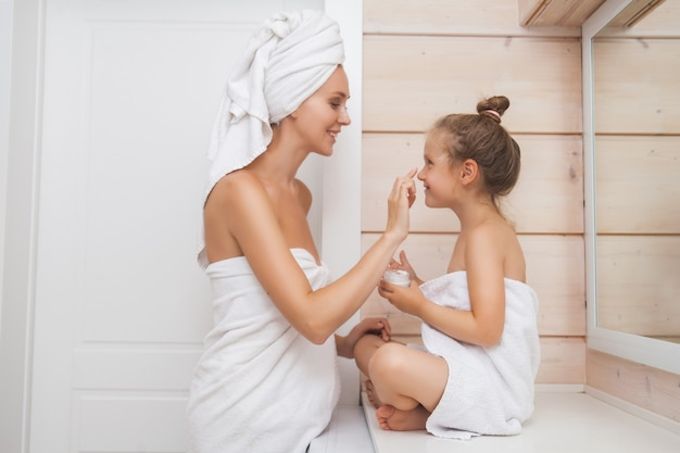 Mother and daughter in the bathroom.