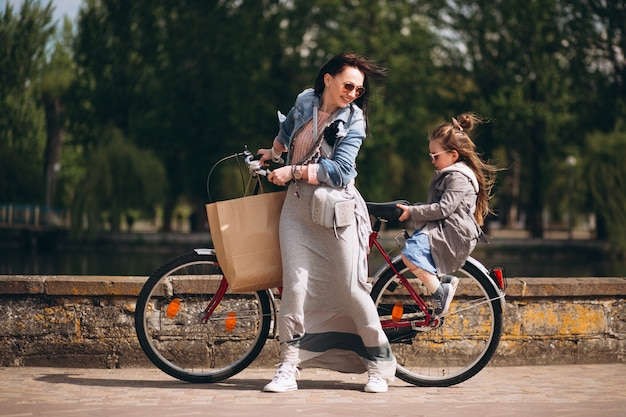 Mother and daughter bicycling