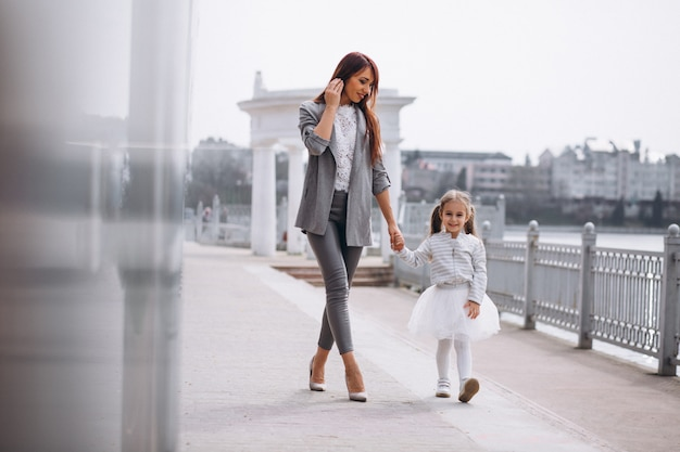Mother and daughter by lake