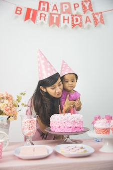 Mother and daughter celebrating birthday