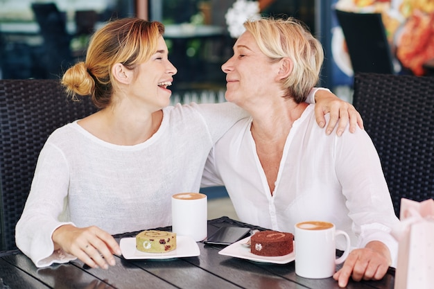 Mother and daughter in coffeeshop