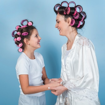 Mother and daughter in curlers laughing