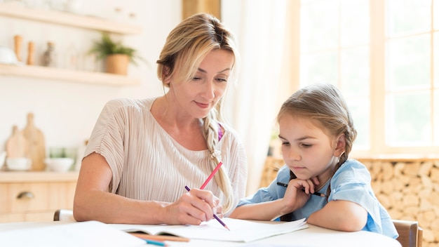 Mother and daughter doing homework at home
