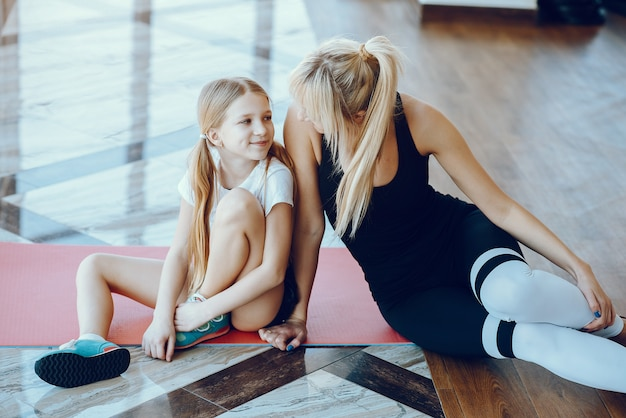 Mother and daughter doing yoga in a yoga studio